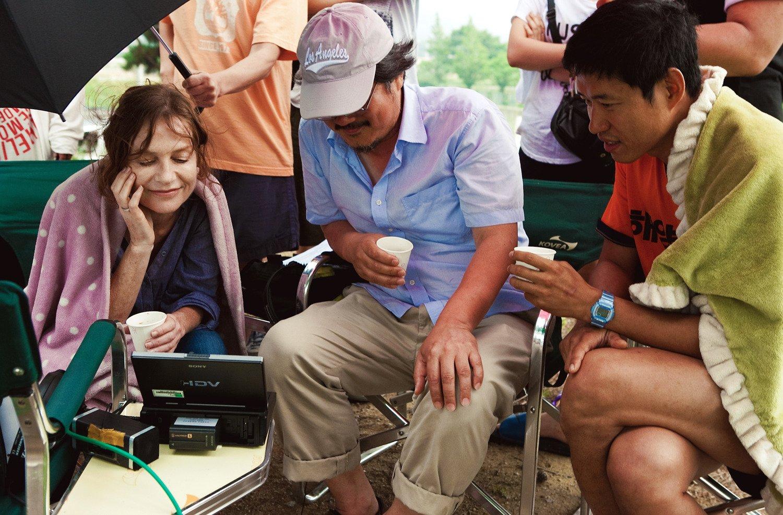 со съемок В другой стране Изабелль Юппер, Хон Сан Су,