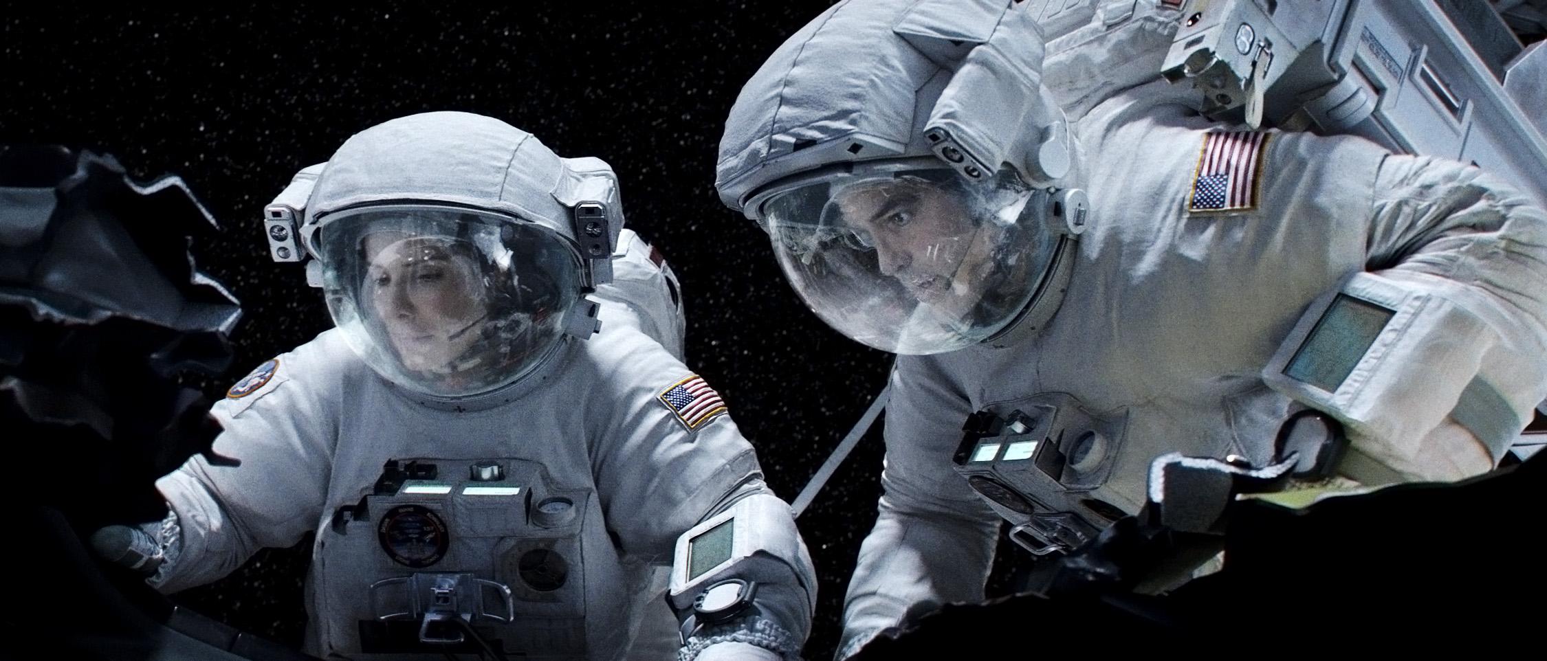 кадры из фильма Гравитация Сандра Буллок, Джордж Клуни,