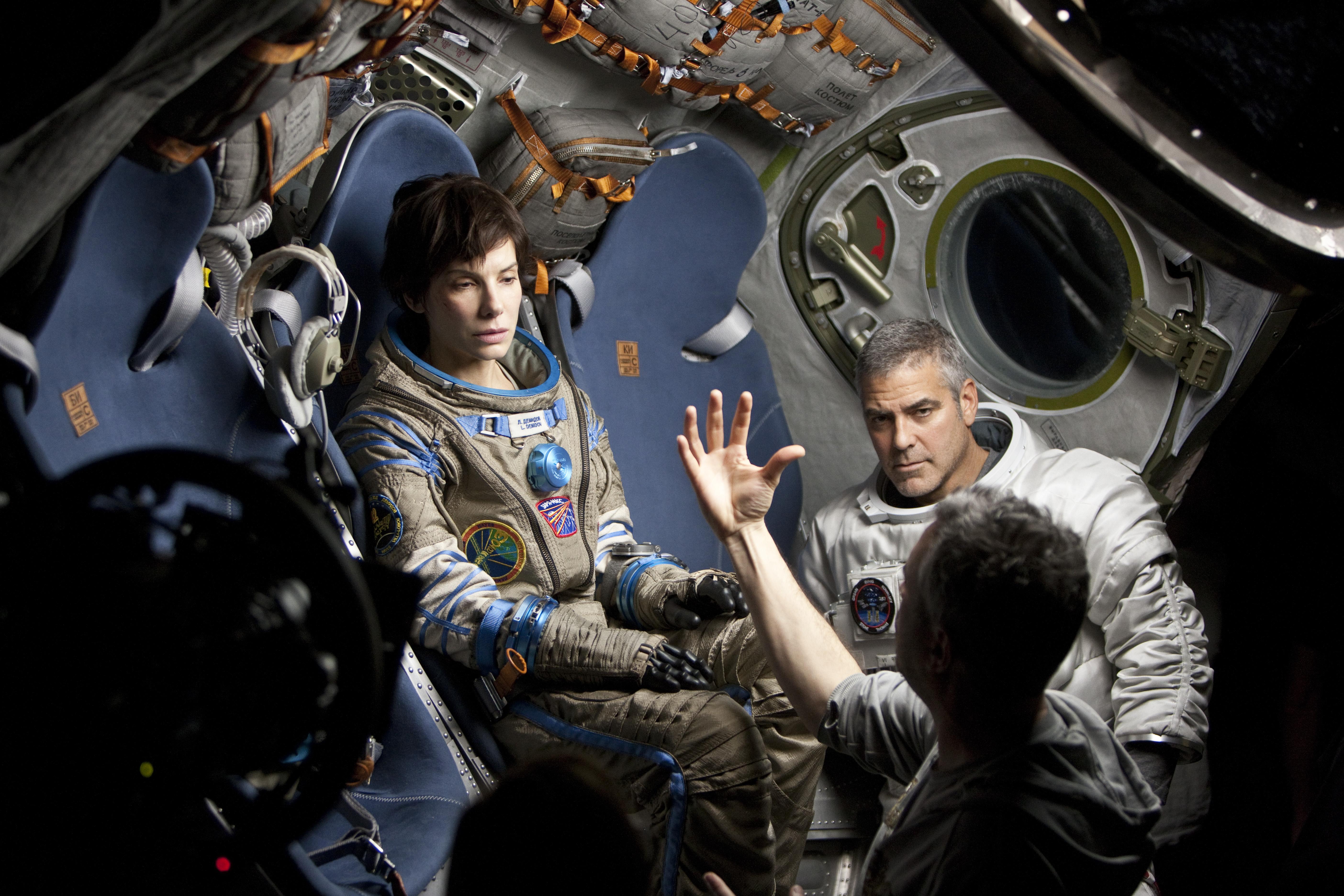 со съемок Гравитация Сандра Буллок, Джордж Клуни, Альфонсо Куарон,
