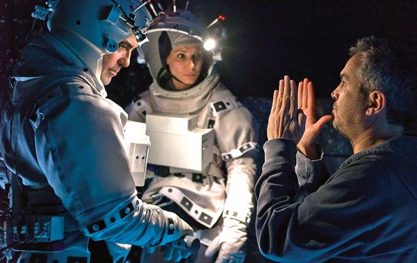со съемок Гравитация Джордж Клуни, Сандра Буллок, Альфонсо Куарон,