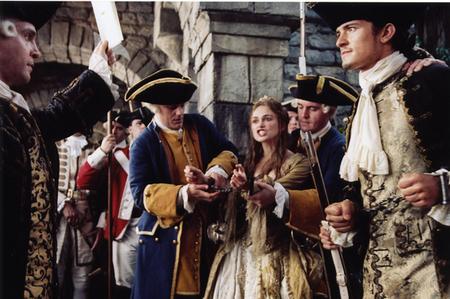 кадры из фильма Пираты Карибского моря: Сундук мертвеца Том Холландер, Кира Найтли, Орландо Блум,